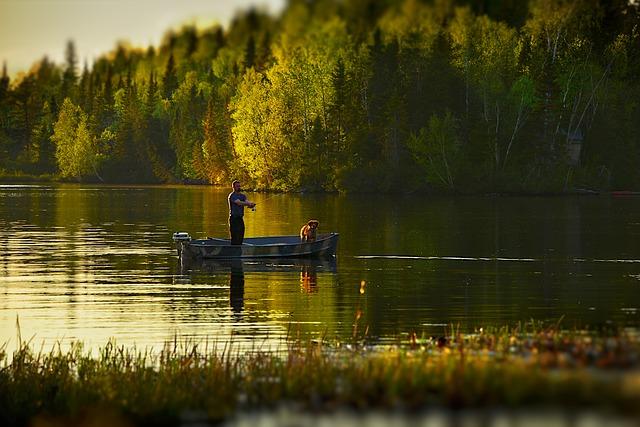 rybář se psem